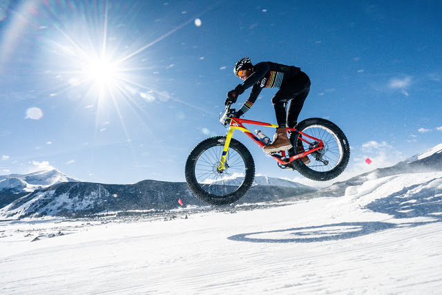 Fat bike rider getting air on the course