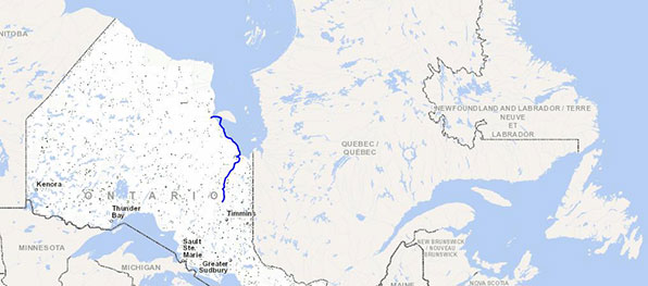 Map of Canadian territories with blue line illustrating bike route in Northern Ontario