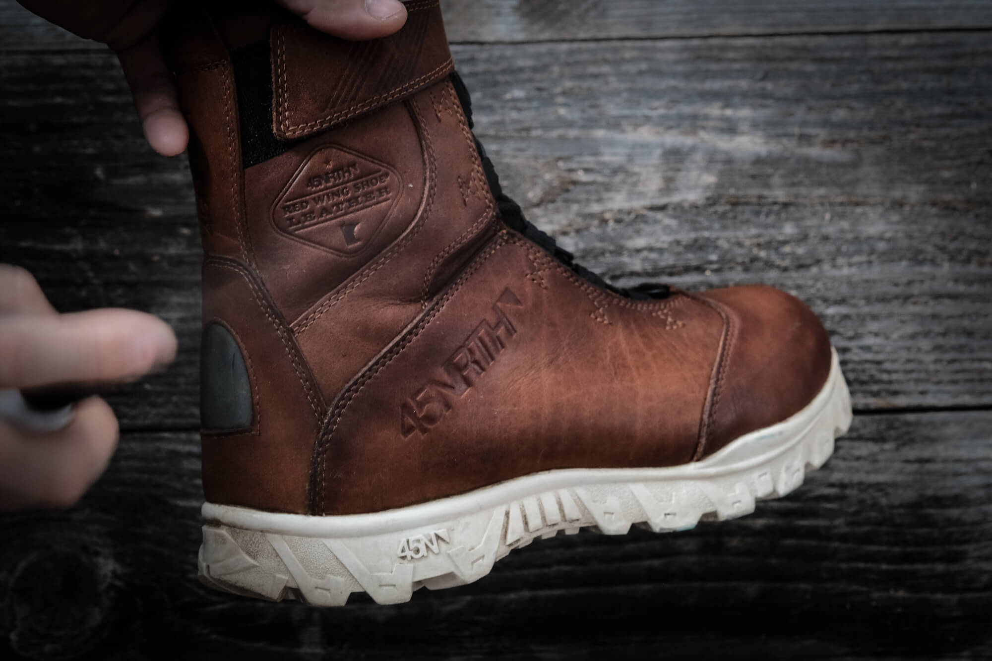 Spraying the leather of the 45NRTH Wolvhammer cycling boot with Red Wing Leather Protector