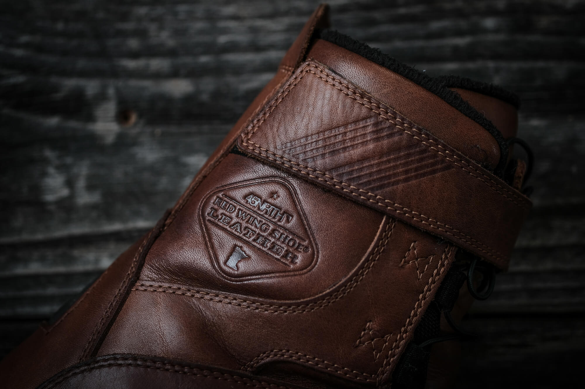 Closeup of 45NRTH Red Wing Shoe Leather logo embedded in leather of conditioned boot