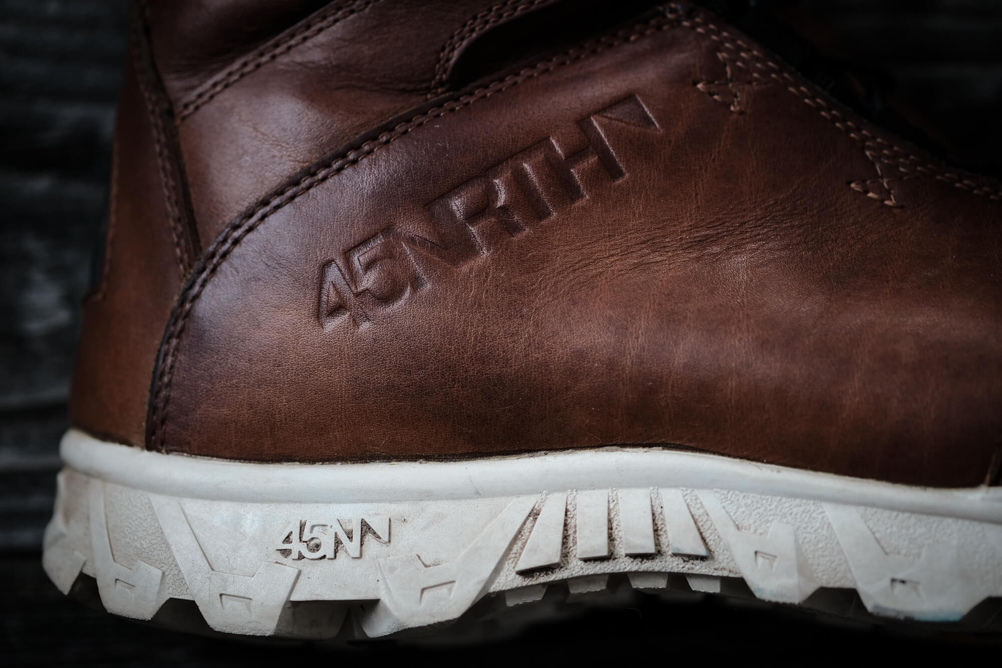 Closeup of 45NRTH logo embedded in leather of conditioned boot