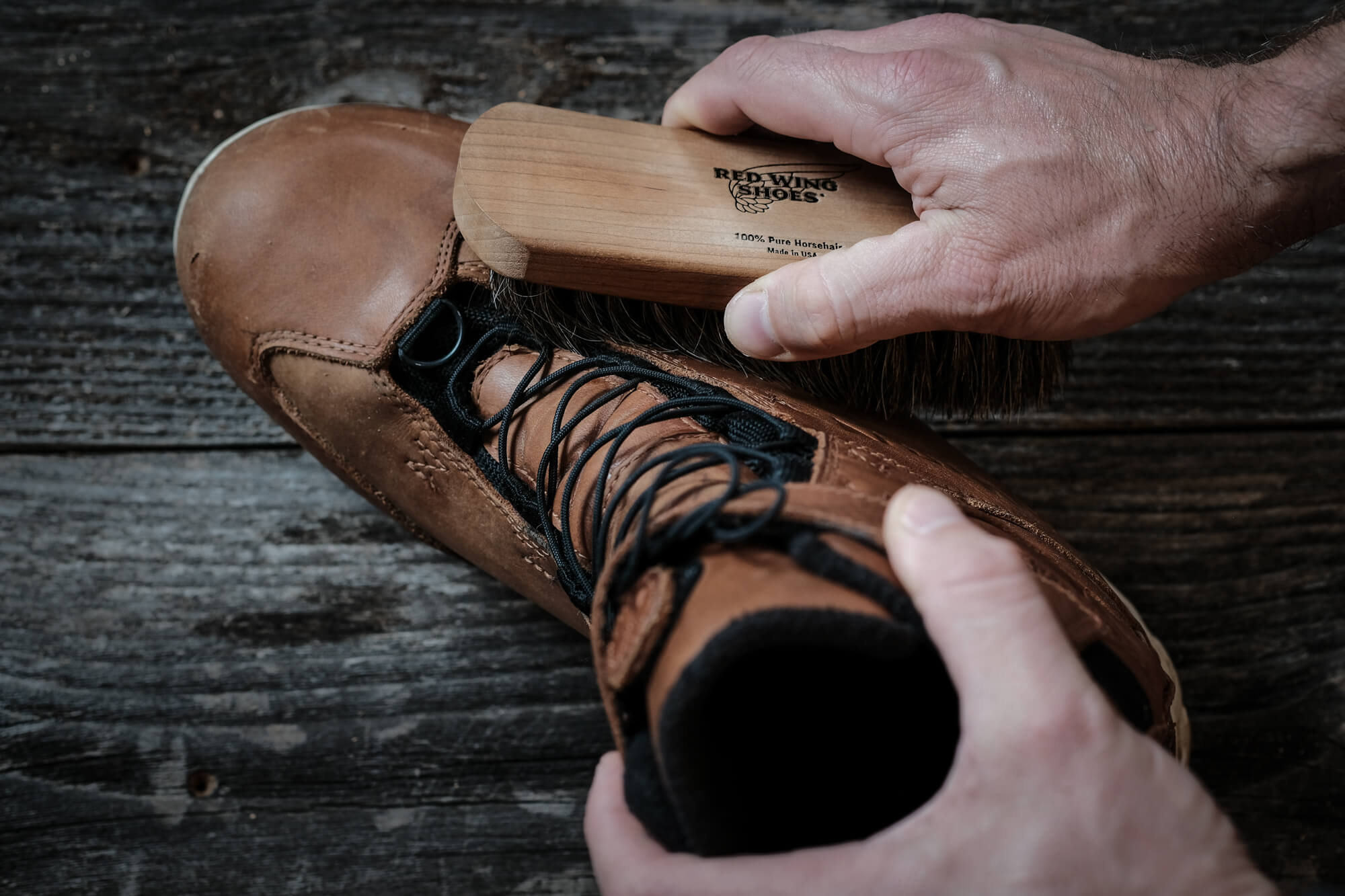 45NRTH Red Wing Wölvhammer cycling boot being brushed with Red Wing cleaning brush