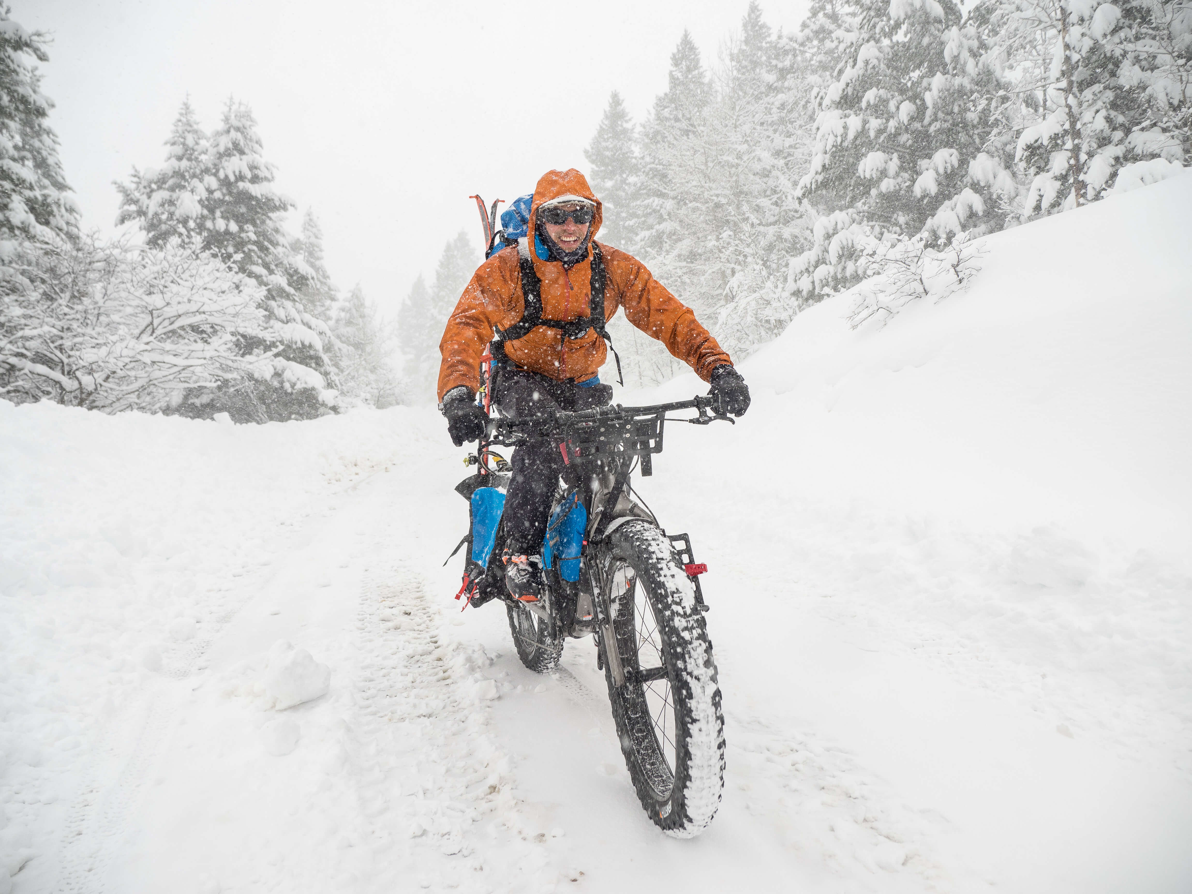 AJ grinning from ear to ear as we ride into the storm in search of powder.
