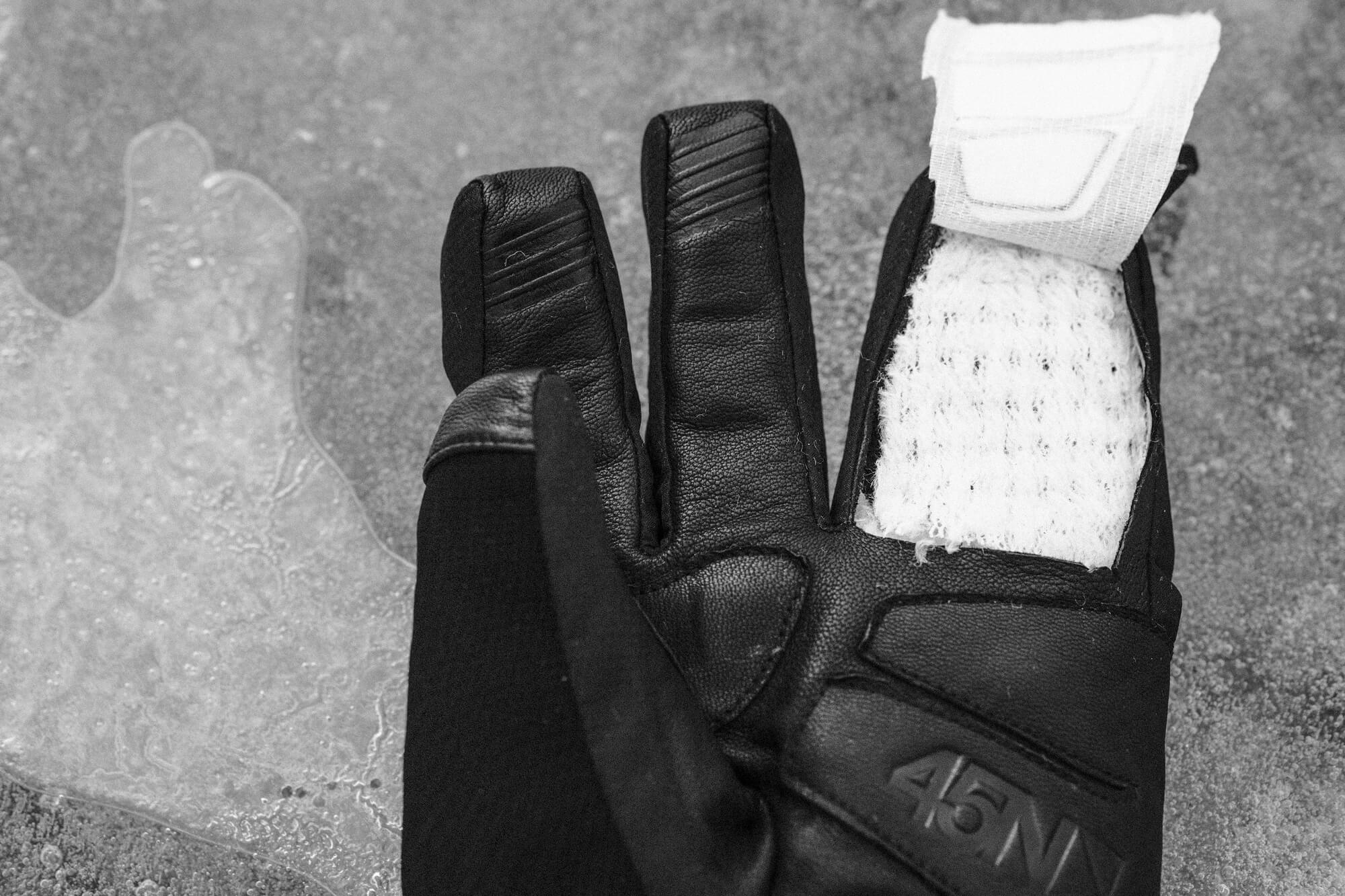 A 45NRTH Sturmfist 4 glove with a cross-section of a finger removed to show Polartec Alpha insulation