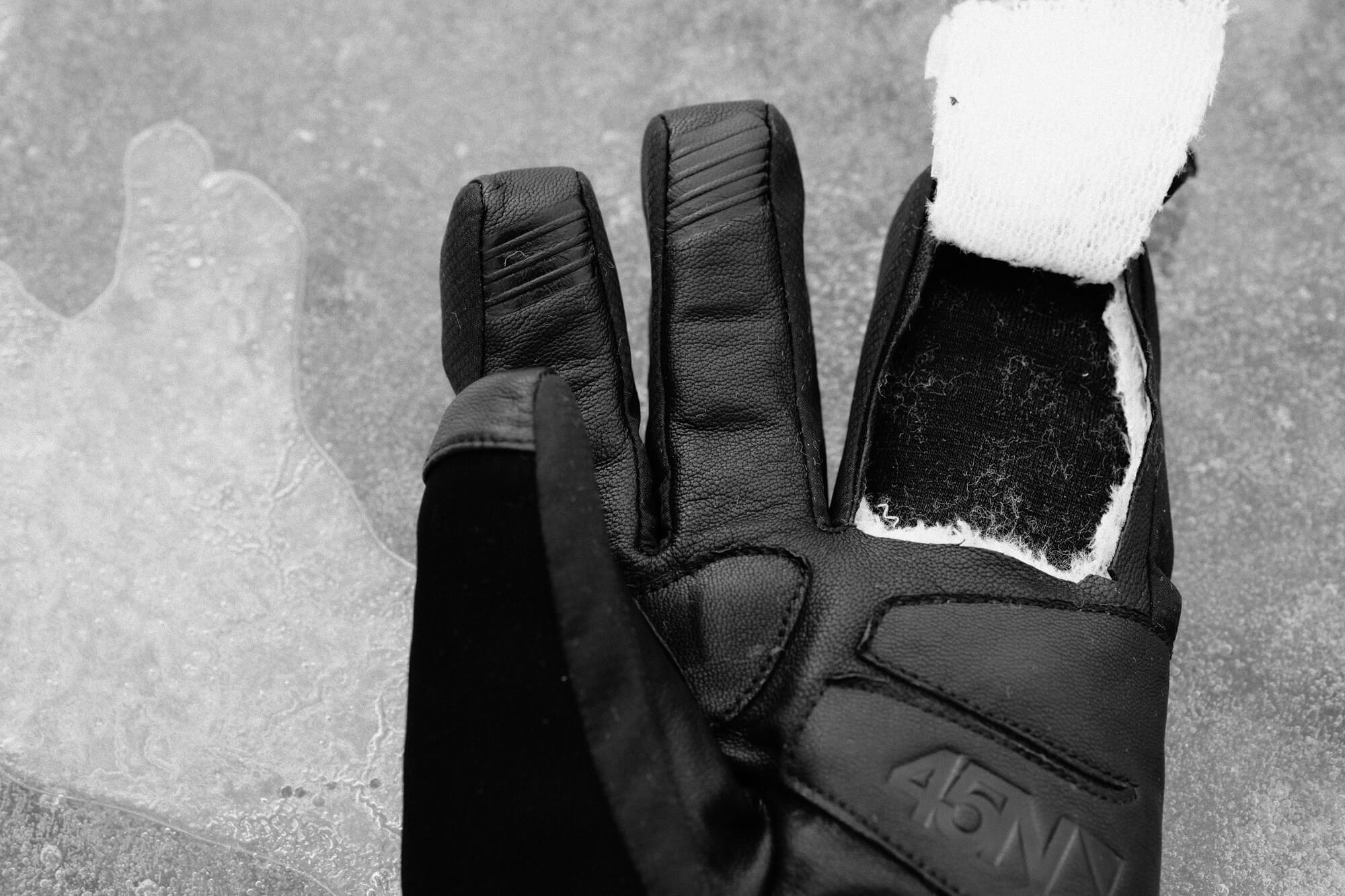 A 45NRTH Sturmfist 4 glove with a cross-section of a finger removed to show Merino wool lining