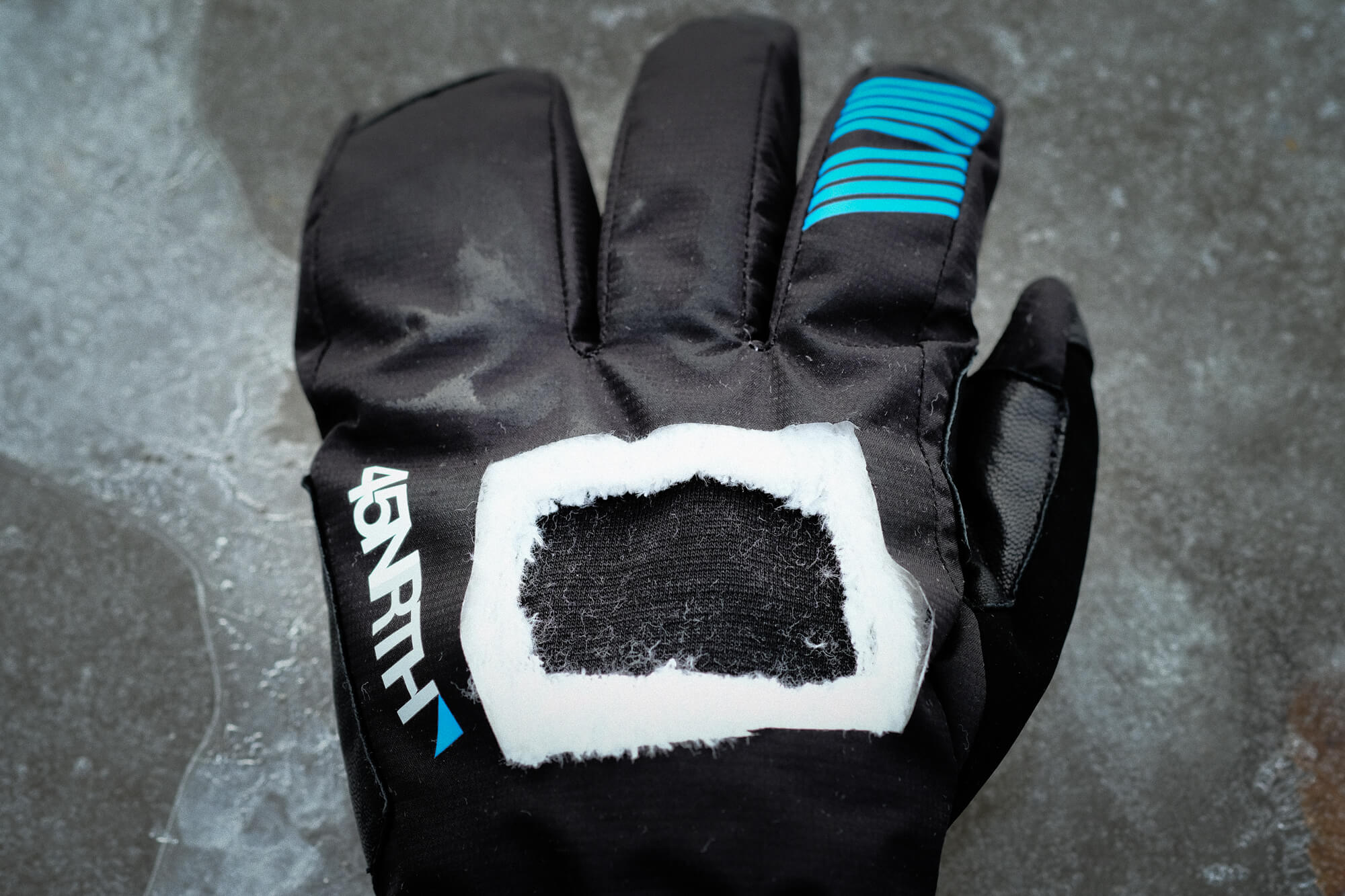 A 45NRTH Sturmfist 4 glove with a cross-section of the back of hand removed to show layers of material and protection