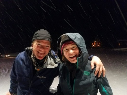 Michelle and Joel smiling while snow is falling