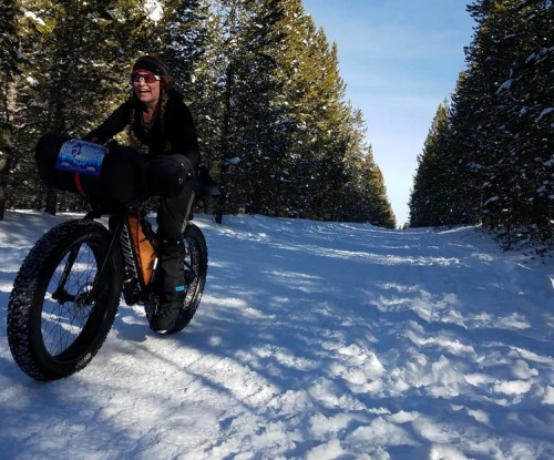 Michelle riding a fat back on a snowy trail