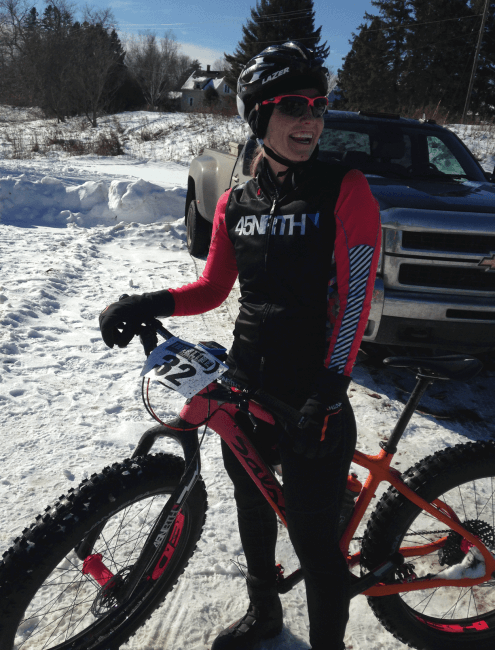 Fat bike rider smiling and laughing in front of a pickup truck